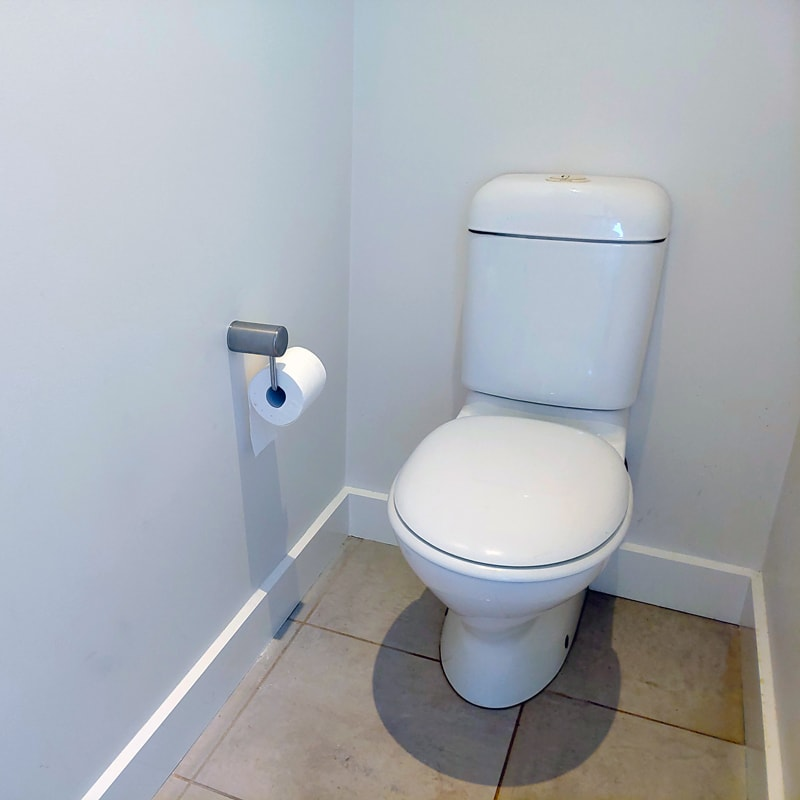 Calibre Heavy Duty Toilet Roll Holder Installed by Toilet